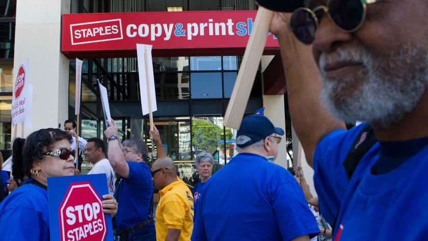 Protesters picket in front of a Staples store in downtown Los Angeles in 2014. The American Postal Workers Union waged a three-year campaign against the chain because of Staples' partnership with the U.S. Postal Service.