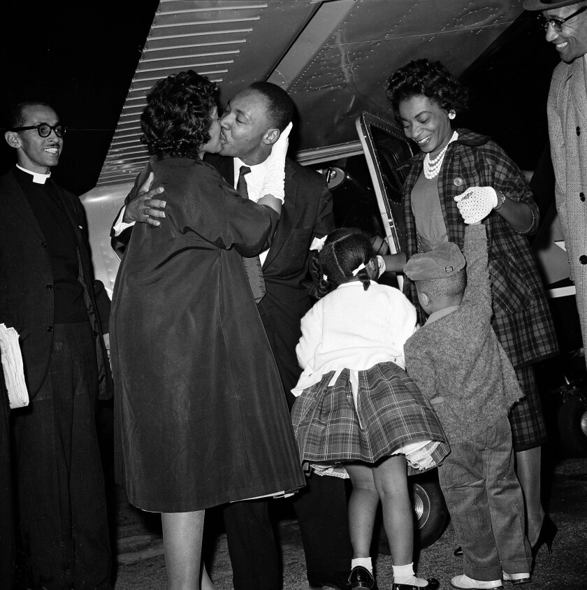 """FILE - In this Oct. 27, 1960 file photo, Martin Luther King Jr. is given a kiss by his wife Coretta as he is welcomed back from Georgia's Reidsville State Prison by demonstrators and family gathered at the DeKalb Peachtree Airport. Following the publication of """"An Appeal for Human Rights"""" on March 9, 1960, students at Atlanta's historically black colleges waged a nonviolent campaign of boycotts and sit-ins protesting segregation at restaurants, theaters, parks and government buildings. (AP Photo, File)"""