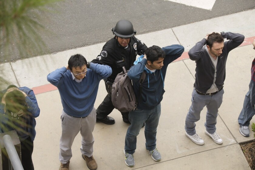 Police check people on the UCLA campus during lockdown.
