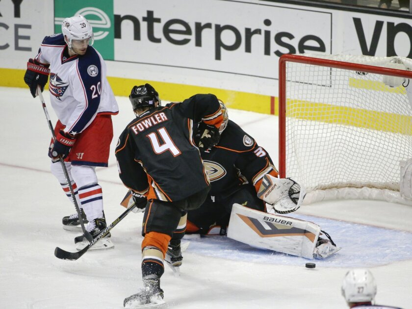 Anaheim Ducks goalie Frederik Andersen kicks out a shot against the Columbus Blue Jackets during the second period of an NHL hockey game Friday, Nov. 6, 2015, Anaheim, Calif. (AP Photo/Lenny Ignelzi)