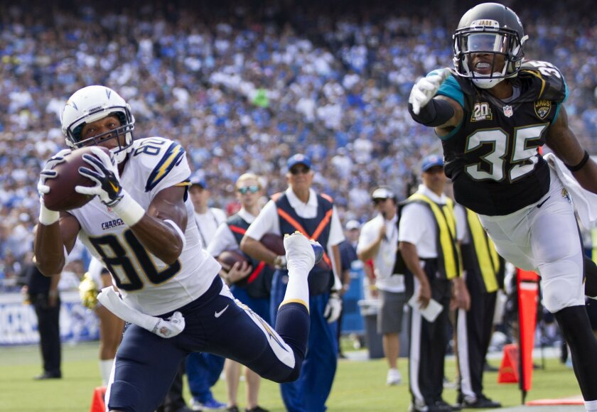 The San Diego Chargers vs. The Jacksonville Jaguars at Qualcomm Stadium.  San Diego Chargers wide receiver Malcom Floyd (80) hauls in this third quarter touchdown pass as Jacksonville Jaguars cornerback Demetrius McCray (35) can't get to it.
