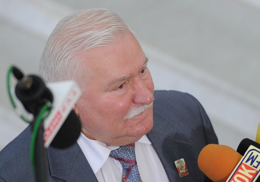 In this Aug. 6, 2015 photo former Polish President Lech Walesa speaks to journalists, in Warsaw, Poland. Allegations that Walesa was a communist-era secret informer have resurfaced after prosecutors seized documents illegally held by a communist-era official's family. (AP Photo/Alik Keplicz)