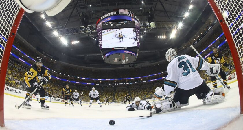 Pittsburgh Penguins' Phil Kessel (81) scores a goal behind San Jose Sharks goalie Martin Jones (31) during the second period in Game 2 of the NHL hockey Stanley Cup Finals on Wednesday, June 1, 2016, in Pittsburgh. (Bruce Bennett/Pool Photo via AP)