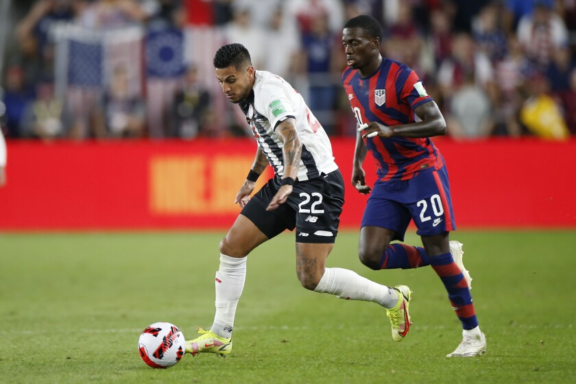 Costa Rica's Ronald Matarita controls the ball as Tim Weah of the United States defends.