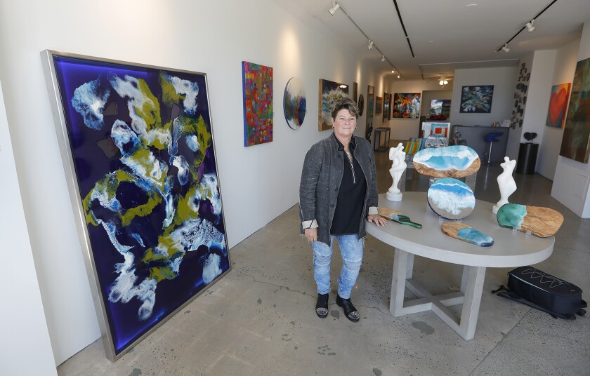 Artist Christie Smith moved from Half Moon Bay in Northern California to open an art gallery in downtown Laguna Beach.