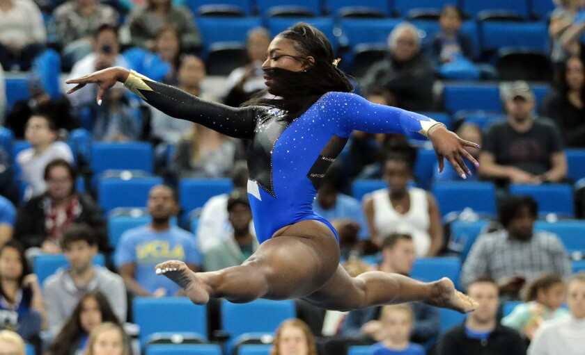 Nia Dennis performs the floor exercise during the UCLA gymnastics exhibition at Pauley Pavilion on Saturday.