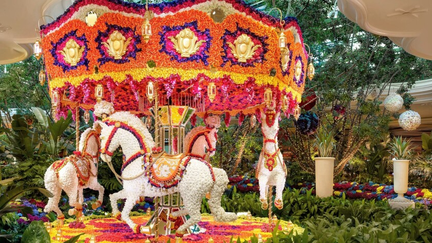 Designer Preston Bailey used tens of thousands of flowers to create a colorful carousel that greets