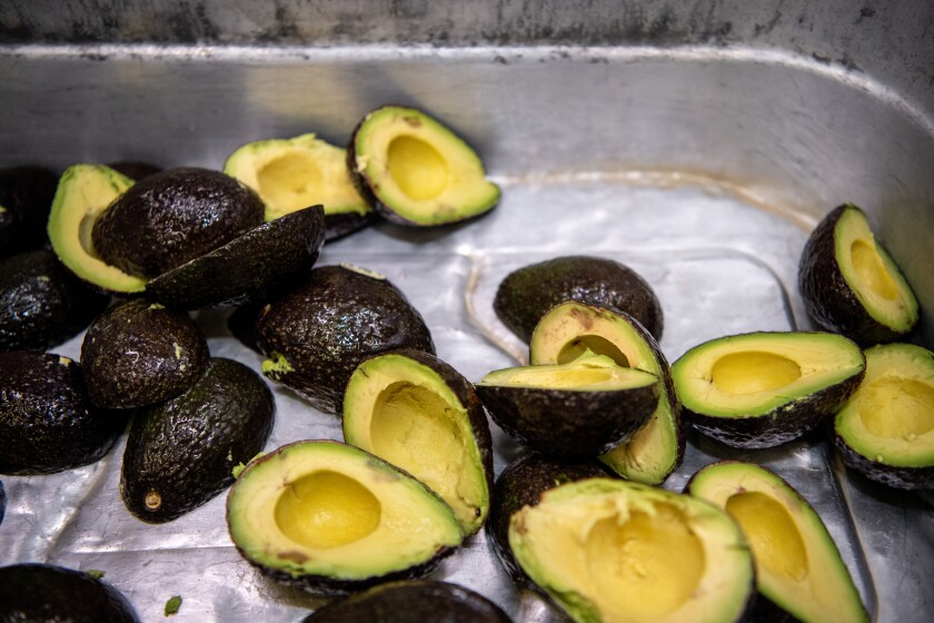 These avocados to make guacamole are prepared at Tito's Tacos in Culver City.