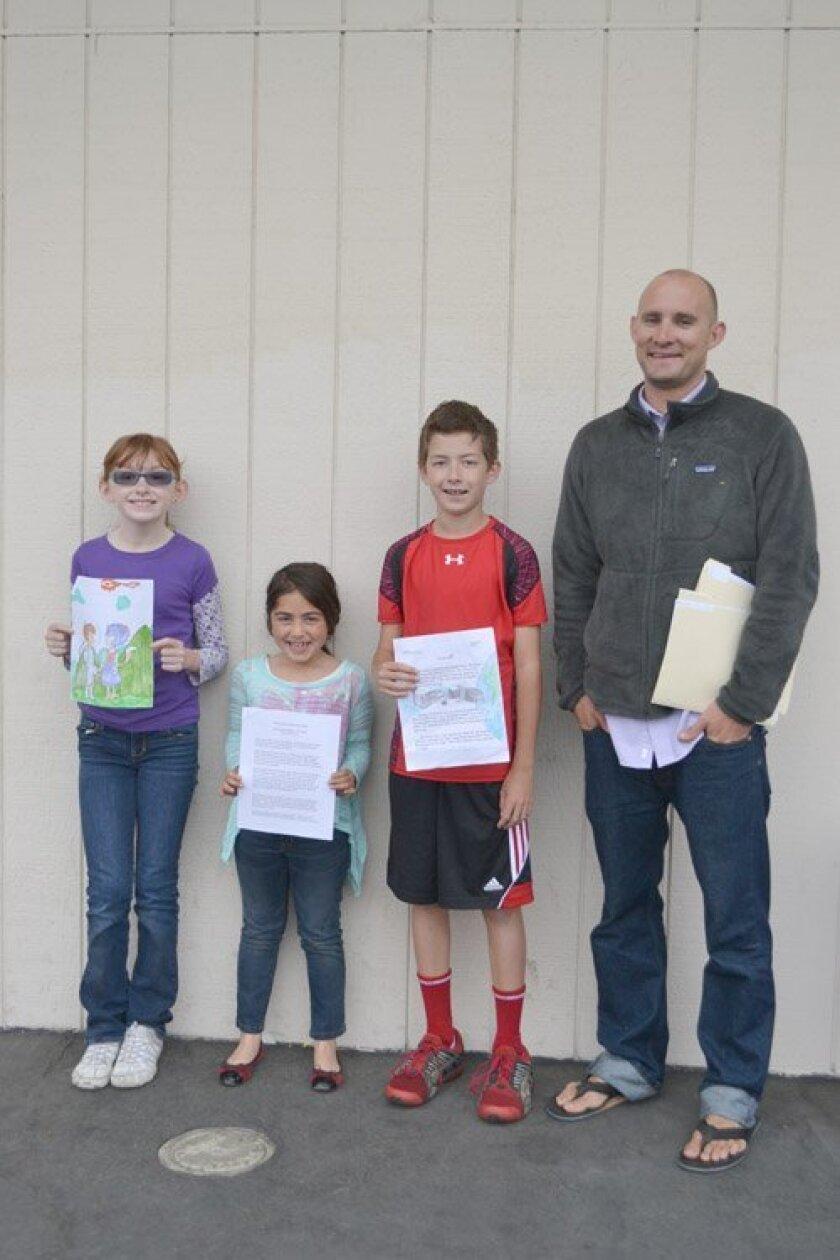 (L-R) Riley Sullivan, Isabella Balikian, Shane Foley and SSF's Science Teacher Kyle Stock.
