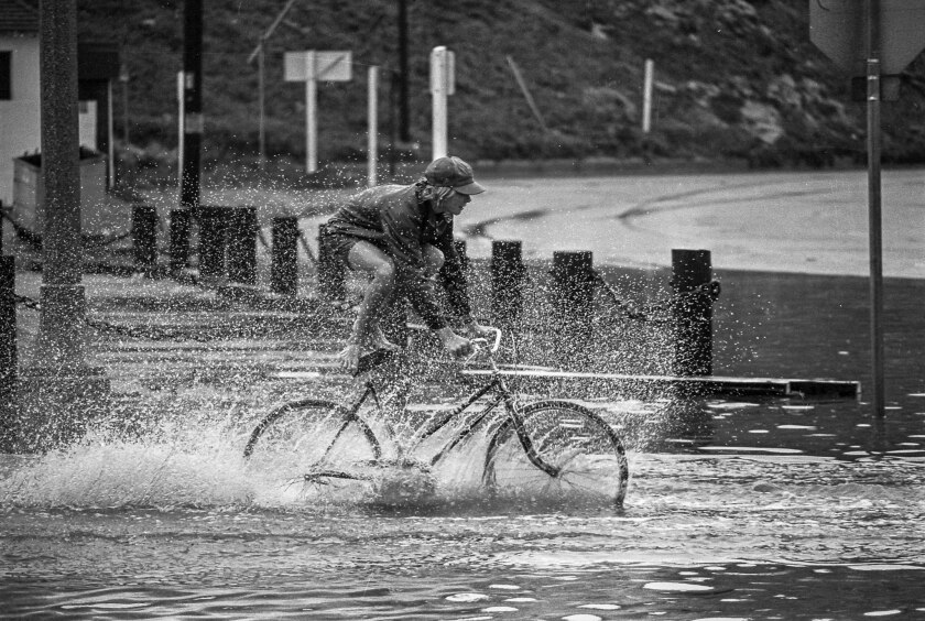 Sep. 10, 1976: A youngster makes the most of the wettest Sept. 10 in local history by gliding bike through a flooded area in Playa del Rey.