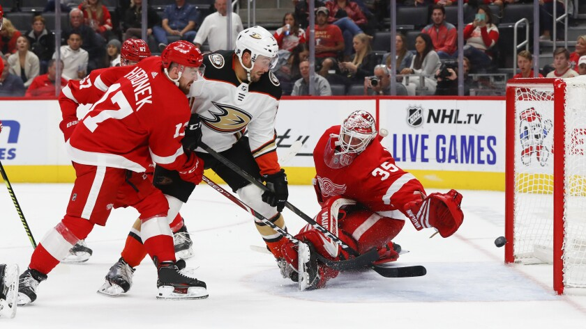 Ducks left wing Nick Ritchie (37) scores on Detroit Red Wings goaltender Jimmy Howard (35) as defenseman Filip Hronek (17) defends in the third period on Tuesday in Detroit.