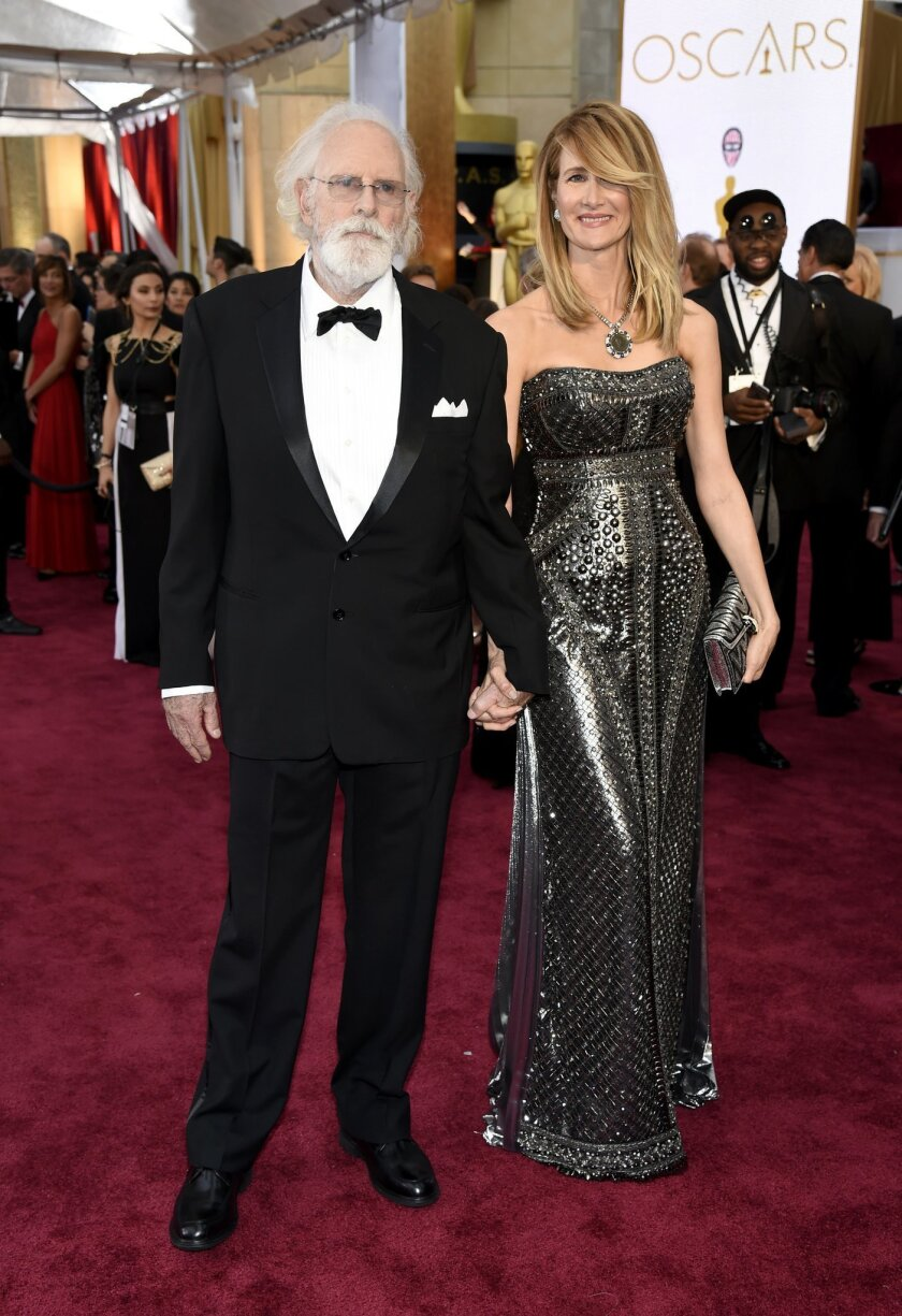 Bruce Dern, left, and Laura Dern arrive at the Oscars on Sunday, Feb. 22, 2015, at the Dolby Theatre in Los Angeles. (Photo by Chris Pizzello/Invision/AP)