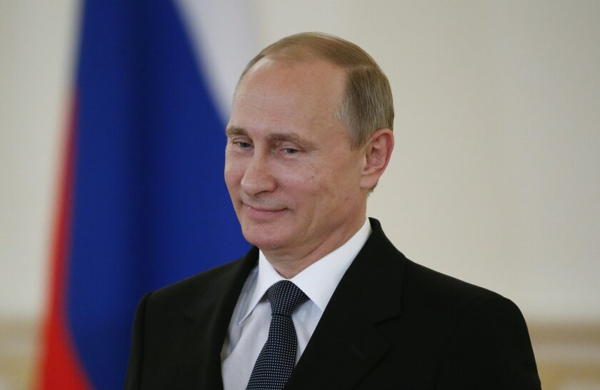 FILE - In this May 28, 2015 file-pool photo,Russian President Vladimir Putin attends a ceremony in the Kremlin in Moscow, Russia. When President Barack Obama and other world leaders gather in Germany next week, Russia's Vladimir Putin will be left off the guest list, part of his punishment for more than a year of alleged aggression in Ukraine. (Sergei Karpukhin/File-Pool Photo via AP)