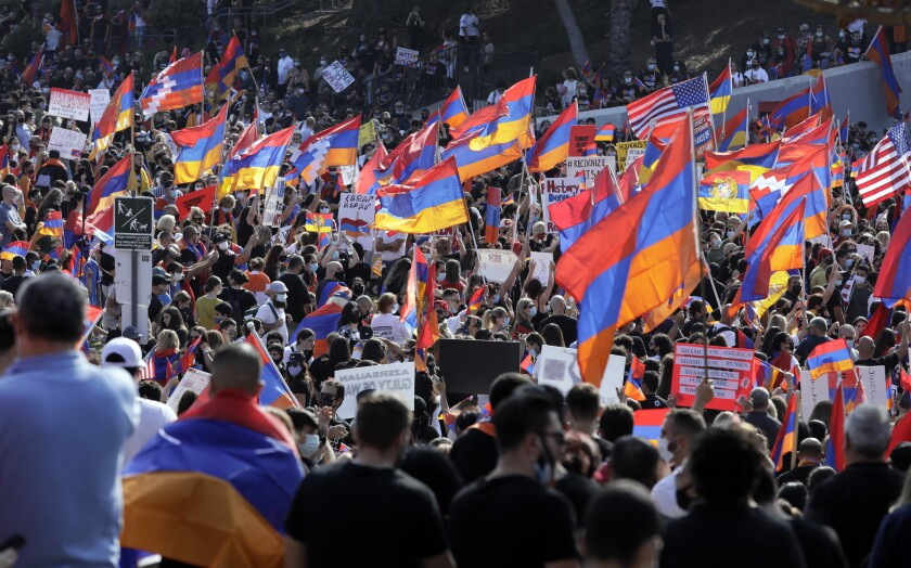 Armenians protest military aggression by Turkey and Azerbaijan during a rally Oct. 11 in Pan Pacific Park in Los Angeles.