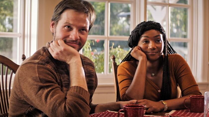 "Ike Barinholtz and Tiffany Haddish in the movie ""The Oath."""