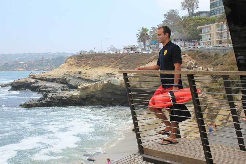 Carefully scrutinizing the beach at La Jolla Cove, lifeguard Rodger Eales is always ready for a rescue.