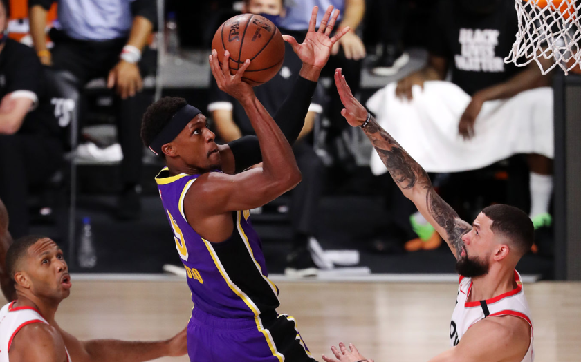 Lakers guard Rajon Rondo shoots during Friday's Game 1 playoff loss to the Houston Rockets.