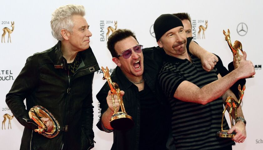"""Members of U2, shown at an awards ceremony in Berlin in November, cheered news that people who received their """"Songs of Innocence"""" album unrequested on Apple iOS devices last year were still listening to the music in January."""