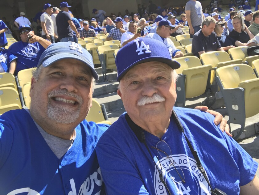Stan Brooks, left, attends opening day at Dodger Stadium in 2018 with his father, Philip.