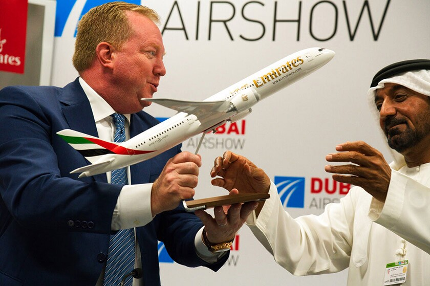 Boeing executive Stanley A. Deal hands a model Boeing 787 Dreamliner to Emirates chief Sheikh Ahmed bin Saeed Al Maktoum