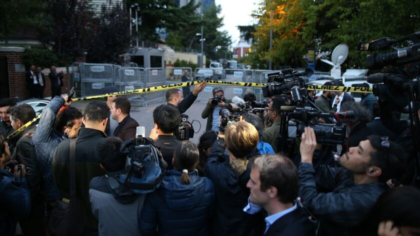 Members of the media work on the blocked road leading to Saudi Arabia's Consulate in Istanbul, Monda