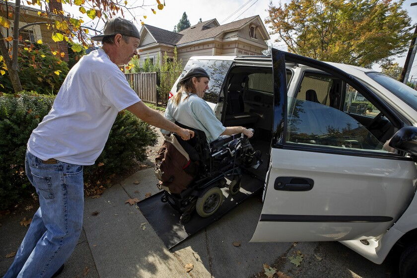 Dirk Collins helps evacuate his brother Darin from their home in Healdsburg, Calif., on Saturday