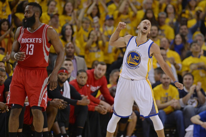 The Golden State Warriors' Stephen Curry reacts after drawing an offensive foul against Houston's James Harden.