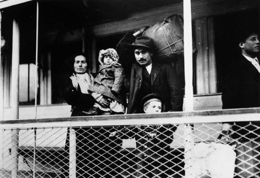 An Italian immigrant family aboard a ferry to Ellis Island, N.Y., circa 1900-1909.