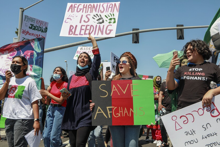 Afghans and supporters march down Pacific Coast Highway during a Stop Killing Afghans rally on Saturday in San Diego.