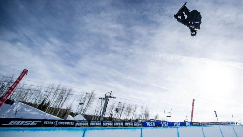 Shaun White makes a practice run before scoring a perfect 100 in the men's snowboard halfpipe finals in Snowmass, Colo. He secured his fourth trip to the Olympics.