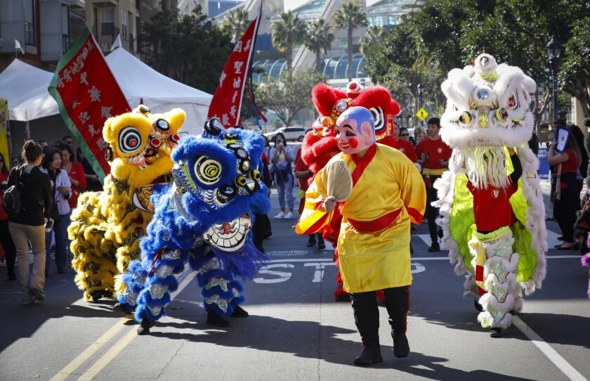 San Diego's Lucky Lion Dancers make their way through the Gaslamp Quarter as the 38th Annual San Diego Chinese New Year Fair marks the Year of the Rat.