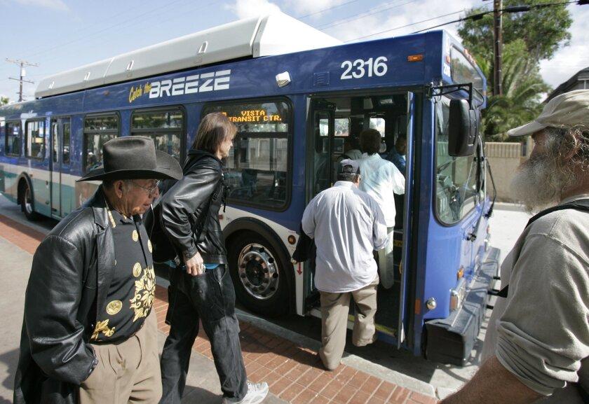 Passengers get on an NCTD Breeze bus at the Oceanside Transit Center. [U-T file]