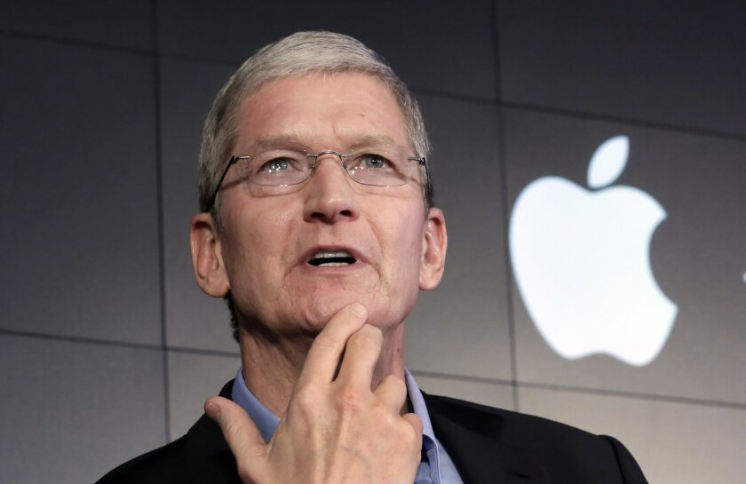 FILE - In this April 30, 2015 file photo, Apple CEO Tim Cook responds to a question during a news conference at IBM Watson headquarters, in New York. The dispute over whether Apple must help the FBI hack into a terror suspect's iPhone is about to play out in a Southern California courtroom. The hearing Tuesday, March 22, in U.S. District Court in Riverside is the first in the battle that has seen Cook and FBI Director James Comey spar over issues of privacy and national security. (AP Photo/Richard Drew, File)