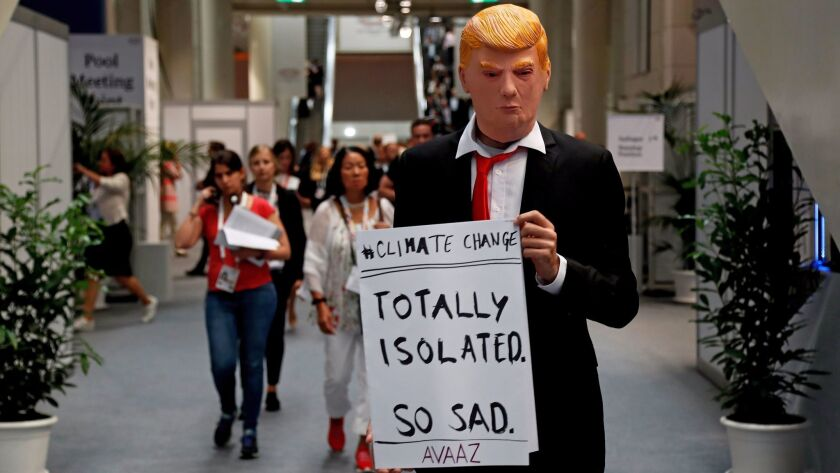 A protester at the G20 summit in Hamburg, Germany, last month demonstrates against President Trump's actions on climate change.