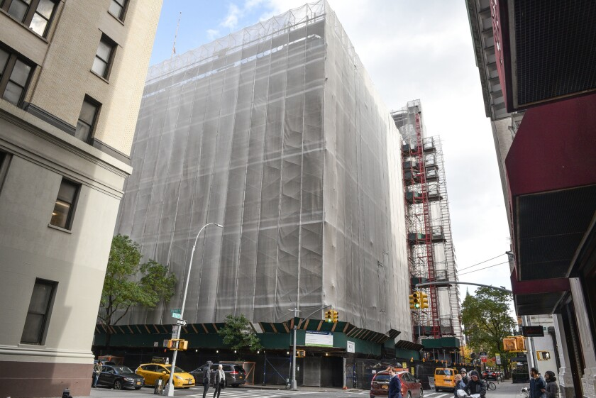 Scaffolding, coverings, and construction zones encompass Washington Irving High School, 40 Irving Place, New York. Novemeber 11, 2018.