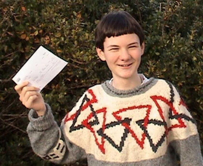 In this photo released by the Fernandez family on Thursday, Jan. 7, 2010, home-schooled Arran Fernandez, 14, poses with the offer he received to join Fitzwilliam College at Cambridge University in October, in London. Fernandez is set to become the university's youngest undergraduate since William Pitt the Younger in 1773, on condition that he passes his physics A-level exam. (AP Photo/PA, Neil Fernandez)