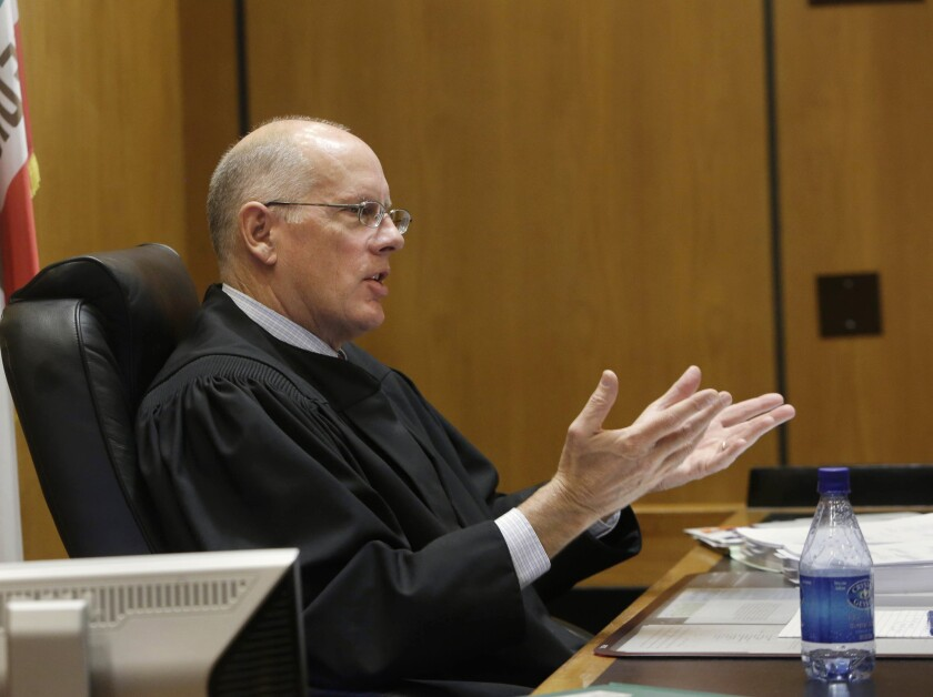 Sacramento County Superior Court Judge Michael Kenny questions attorney Stuart Flashman, who is representing opponents of California's high-speed rail project, about the lawsuit seeking to halt funding for the bullet train on the grounds that the project violates promises made to voters.