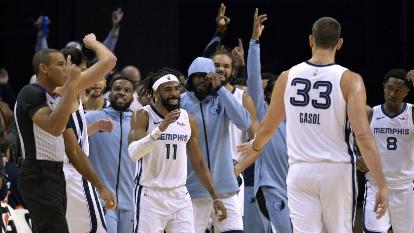 Teammates react after Memphis Grizzlies guard Mike Conley (11) made a three-pointer to beat the buzzer at the end of the first half against the Clippers.