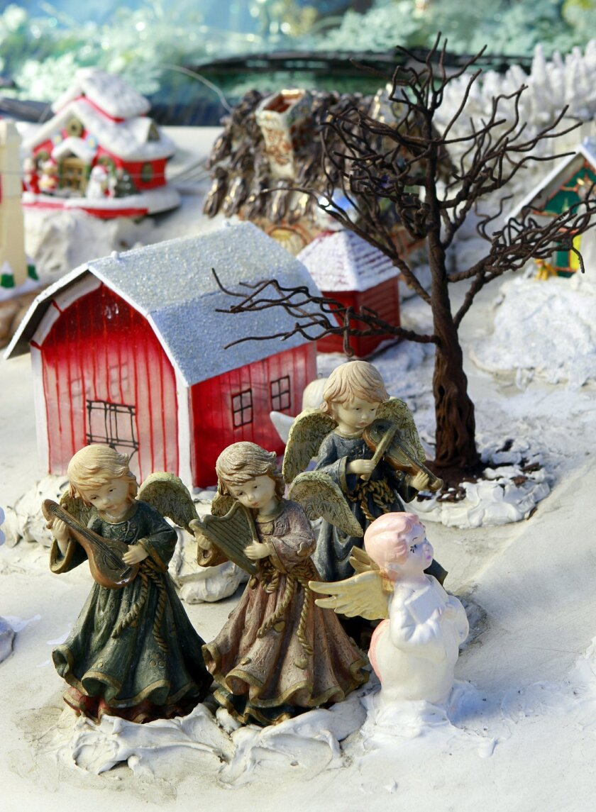 Tiny Christmas displays on and inside the yule van add up to an impressive whole.