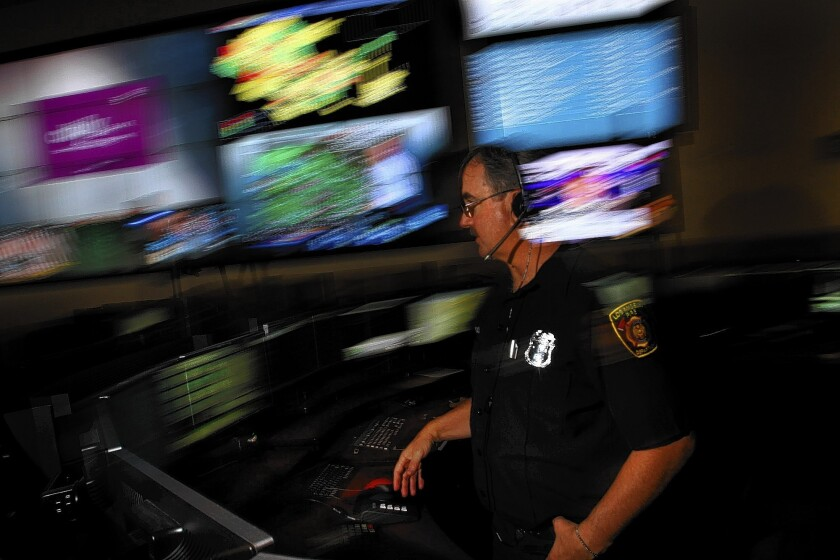 LAFD dispatcher Steve Bloch talks with a colleague about a call. In 2012, a Times analysis found the LAFD call center fell far short of a national standard that rescue units be alerted within one minute on 90% of 911 calls.