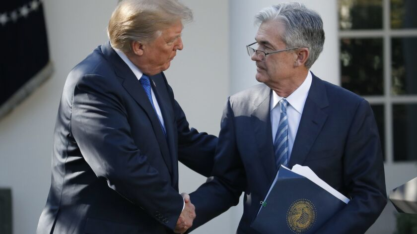 President Trump shakes hands with Jerome H. Powell after announcing him as his nominee to chair the Federal Reserve last year.