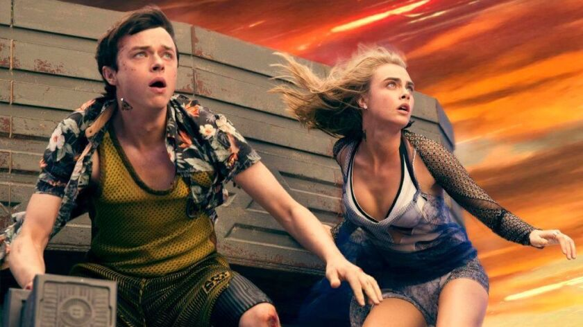 "Dane DeHaan as Major Valerian and Cara Delevingne as Sergeant Laureline in Luc Besson's ""Valerian an"