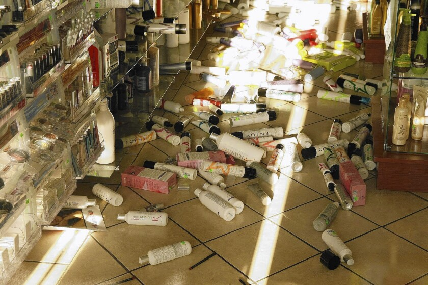 Products lie on the floor of the Sherman Oaks Beauty Center after a magnitude 4.4 earthquake centered in Encino on Monday. Scientists and private companies are working on a statewide early warning system to alert emergency responders and the public to oncoming quakes.