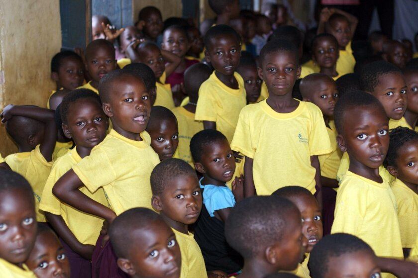Some of the 150 children that greeted the author and her husband on their visit to the village of Kibirizi. Marlise Kast-Myers photo