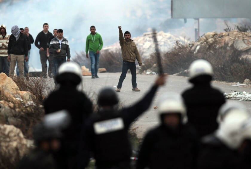 Young residents of the refugee camp Jalazoun on Sunday clash with Palestinian police as they block the main road leading to the West Bank city of Ramallah.