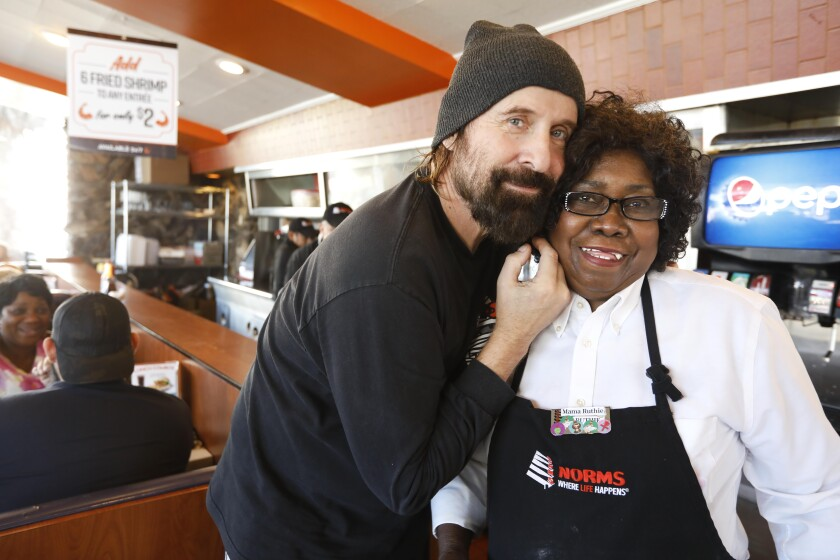 Actor Peter Stormare and waitress Ruthie Krocker at Norms in West Hollywood