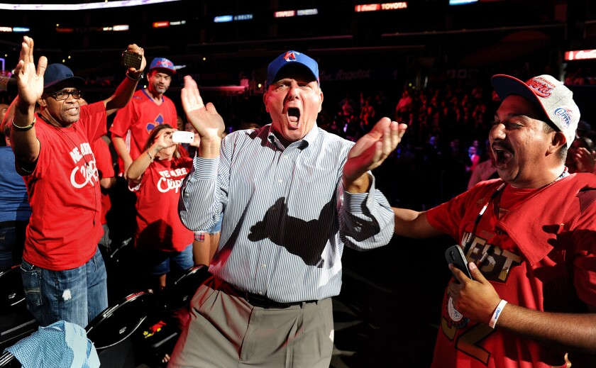 New Clippers owner Steve Ballmer greets fans during a rally at Staples Center on Monday.