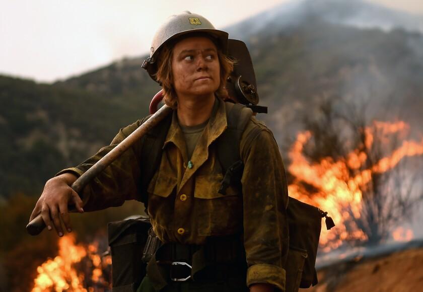 Arroyo Grande Hot Shot firefighter Shelby Robinette takes a break as crew members set back fires as the El Dorado Fire.