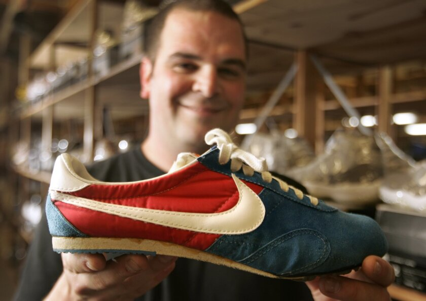 Jordan Geller holds one of the shoes Nike made for American running sensation Steve Prefontaine to wear in the 1976 Summer Olympics in Montreal, Canada. Prefontaine died before the games. Geller bought the shoes for $3,383.