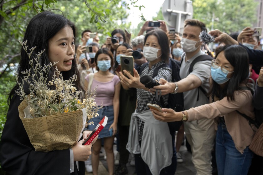 Zhou Xiaoxuan, a former intern at China's state broadcaster CCTV, speaks outside a courthouse before attending a session in her court case against a television host she accuses of groping and forcibly kissing her in Beijing, Tuesday, Sept. 14, 2021. Zhou became the face of the country's MeToo movement after going public with accusations against a prominent CCTV host in 2018. Since then, even as the movement was shut down by authorities, Zhou has continued to speak out. (AP Photo/Mark Schiefelbein)
